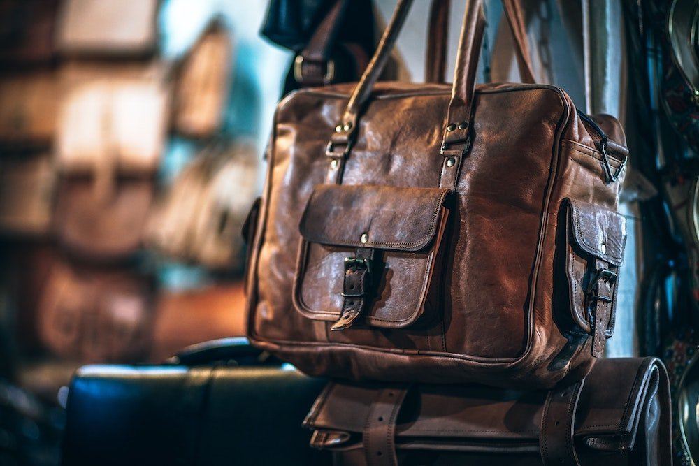 Leather boarding bag and a suitcase