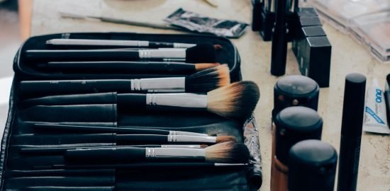 Makeup brushes in a makeup bag