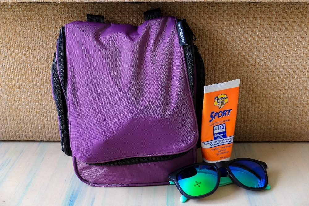 Neatpack toiletry bag and sunscreen