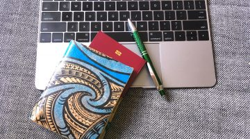 Green Banana Paper Travel Wallet and a Laptop