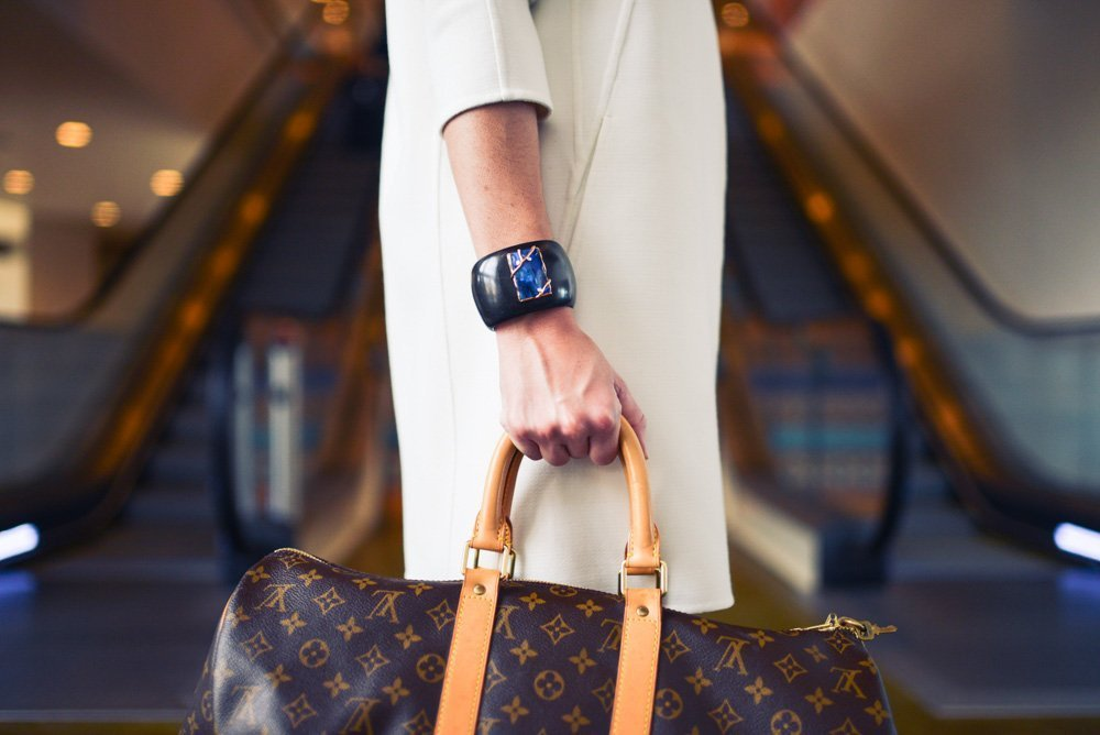 A woman with a duffel bag - Best duffel bags for travel