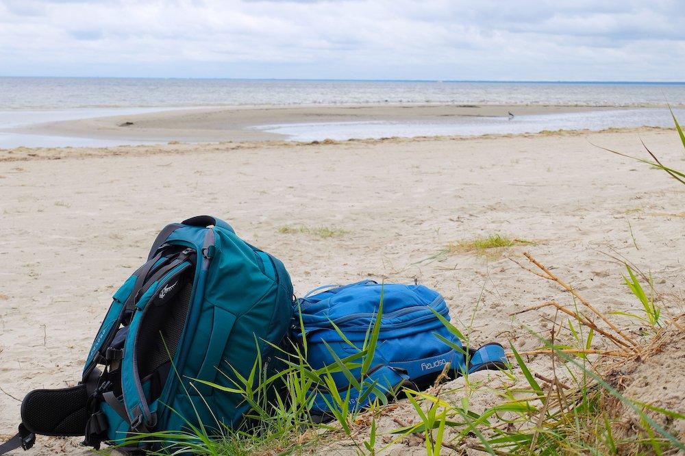 Osprey backpacks on a beach