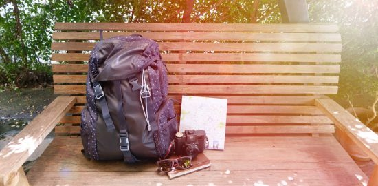 Backpack on a bench - Packing essentials