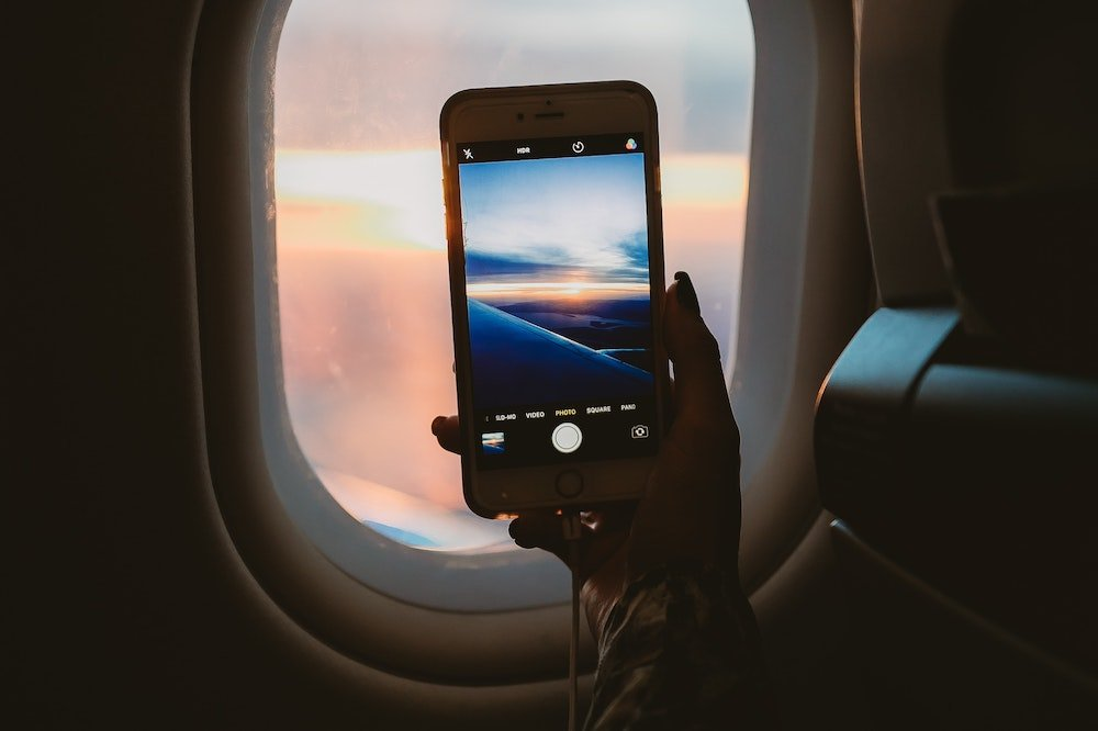 Taking a photo on a plane