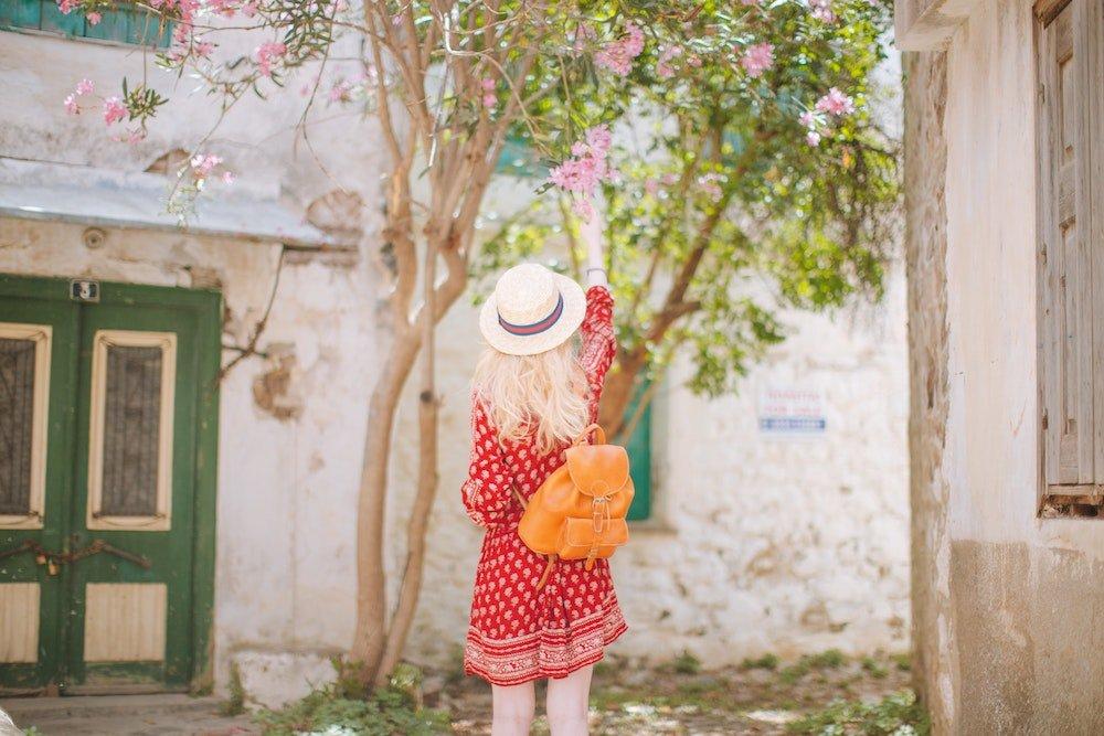 Girl reaching for the flower
