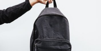 A person holding a backpack - Best cheap backpacks