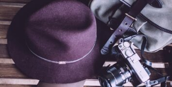 A bag, hat and a camera