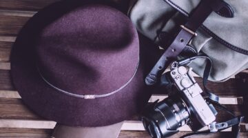 A bag, hat and a camera